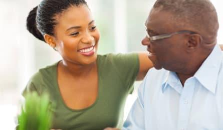 woman smiling to senior man