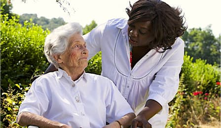 caregiver looking at senior woman