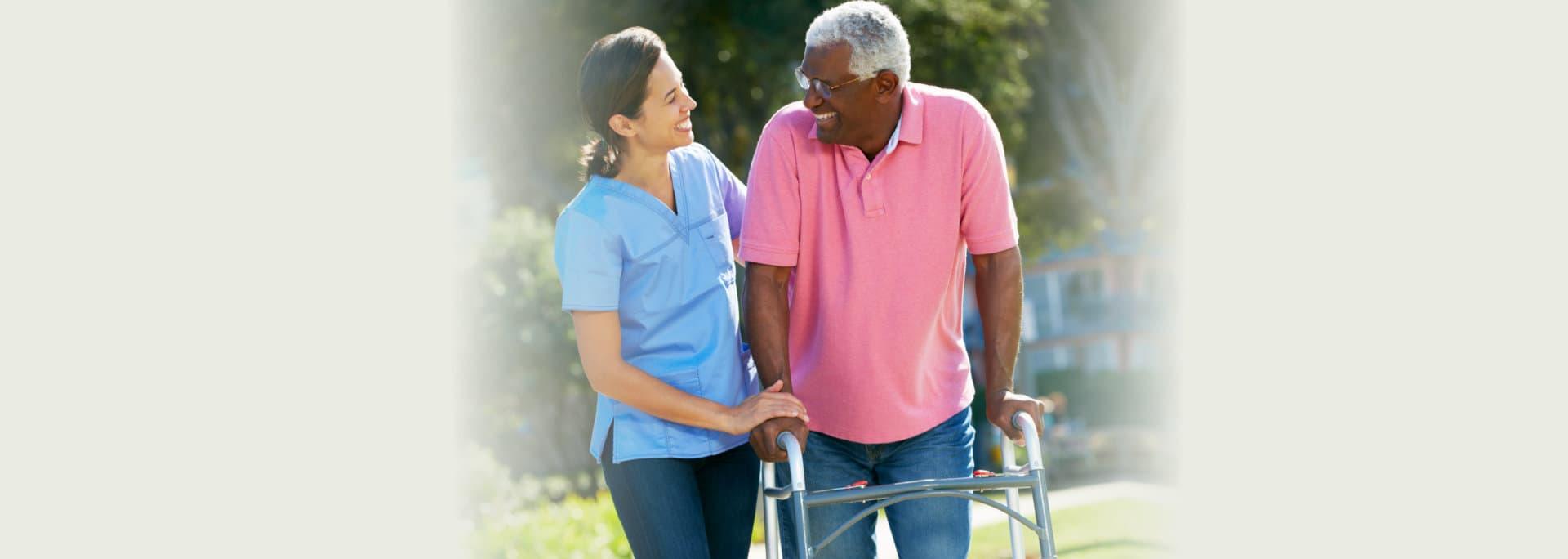 caregiver and senior man laughing