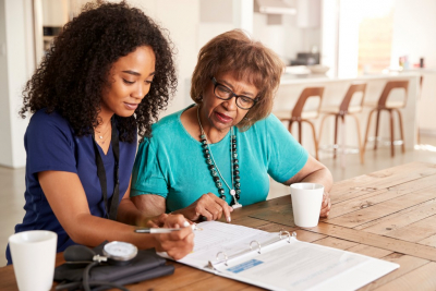 healthcare worker with a senior woman