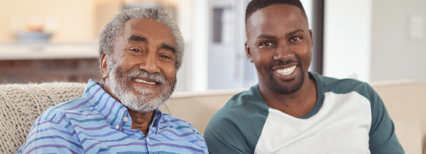 man and senior man smiling